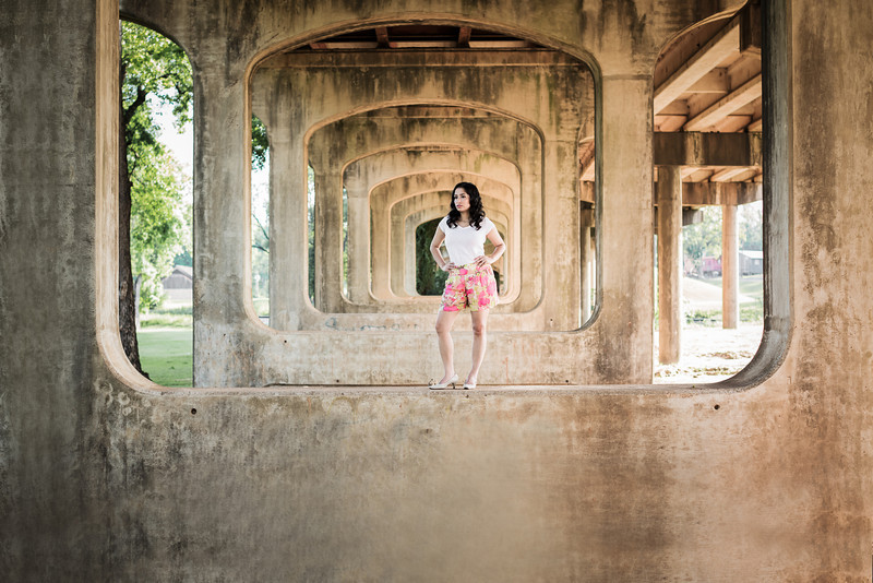 Under the Bridge, Nacogdoches TX<br /> <br /> Nini and I have big news but I'm not able to say anything about it until Monday.  But, in celebration, she had her hair and makeup done at Julia's Salon, and we went for a photoshoot.  I have seen several local photographer shooting at this location before and figured we should try it out.  I'm glad we did!  We only spent about 10 minutes there but it was fun lifting Nini up into place.<br /> <br /> I did some wacky processing on this photo!  I expanded the concrete frame around the outside of the photo so that I could make a better crop and there wouldn't be distracting dirt and rocks in the frame below.  The powers of photoshop are amazing.  <br /> <br /> Critiques are always welcome.<br /> <br /> Daily photo: May 12, 2013, taken May 10, 2013