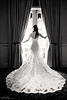 """Dramatic Beauty, Houston TX  Colleen and Jonovan's downtown Houston wedding was one of my favorites of the season.  The bride was gorgeous, Jonovan was a great sport, and most of all, everyone had an amazing time!  Thanks to the amazing <a href=""""http://www.thesilhouettestudio.com"""">Sarah Williams</a> for bringing me along!  This is a classic bridal portrait.  I've seen this type of photo in a lot of pro wedding photographer's portfolios, so I started planning this shot when we were shooting details outside the window!  When we got inside and saw the nice vertical lines, the composition and lighting was simple!  Colleen's natural grace and Sarah's posing tips did the rest!  My fan asked about my new gallery style for my daily gallery.  I've switched to journal mode so that the gallery looks more like a blog.  You can still comment by clicking the photo, and clicking the """"show details"""" button right above the photo (near the middle).  I like the journal style better because it shows all of the photos in large size, which is how I think they deserve to be seen!  I also have ulterior motives.  The blog button on <a href=""""http://www.paulbellinger.com"""">my new website</a> currently links to my daily gallery, so I want it to actually look like a blog.  I might change it back once my actual blog is up and running.  So much to do!  UPDATE:  My site is now live at www.paulbellinger.com!  Yea!  I got the domain I wanted originally.  It became available over the weekend and I snatched it up!  Critiques are always welcome.  Daily photo: June 3, 2013, taken May 17, 2013"""