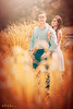 """Fields of Fantasy, Houston TX  Rachel and Ryan's fantasy love story has taken to the fields!  I've tried to create a some consistency with the previous <a href=""""http://smu.gs/16P0fEo"""">fantasy engagement photo</a> I made for them.  Rachel's bridals are coming up soon and I can't wait!  Thanks to the amazing <a href=""""http://www.thesilhouettestudio.com"""">Sarah Williams</a> for providing this opportunity for me!  Rachel and Ryan mentioned they really like colorful photos, so I created something much more colorful than what was there at Hermann Park in downtown Houston.  All of the foliage you see in the frame was green!  I changed it to orange/red/yellow using Photoshop CS6.  I also added the sun flare light in the background.  The goal was to create a photo that the clients will love, while staying true to my brand.  What is my brand?  Well I've been trying to narrow down my branding words, the words that I want my photos/website/logo etc to convey, and I've come up with: romantic, dramatic, fantasy and artwork.  I think this photo meets all four of those words after processing, but was only romantic straight out of camera.  What do you think?  Critiques are always welcome.  Daily photo: June 7, 2013, taken May 24, 2013"""